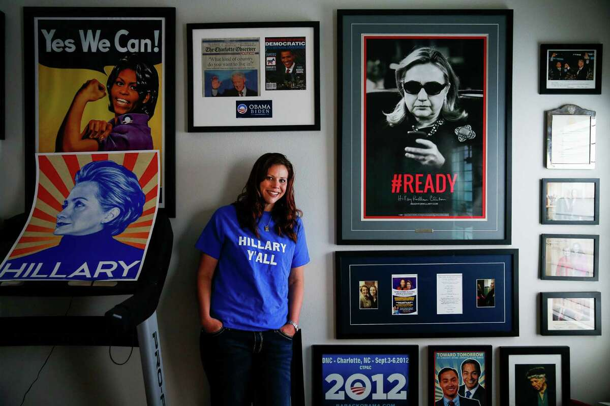 Hillary Clinton supporter and founder of HRC Super Volunteers Kim Frederick stands for a portrait in a room of her house filled with political signs, buttons and photos Wednesday, Nov. 2, 2016 in Houston.