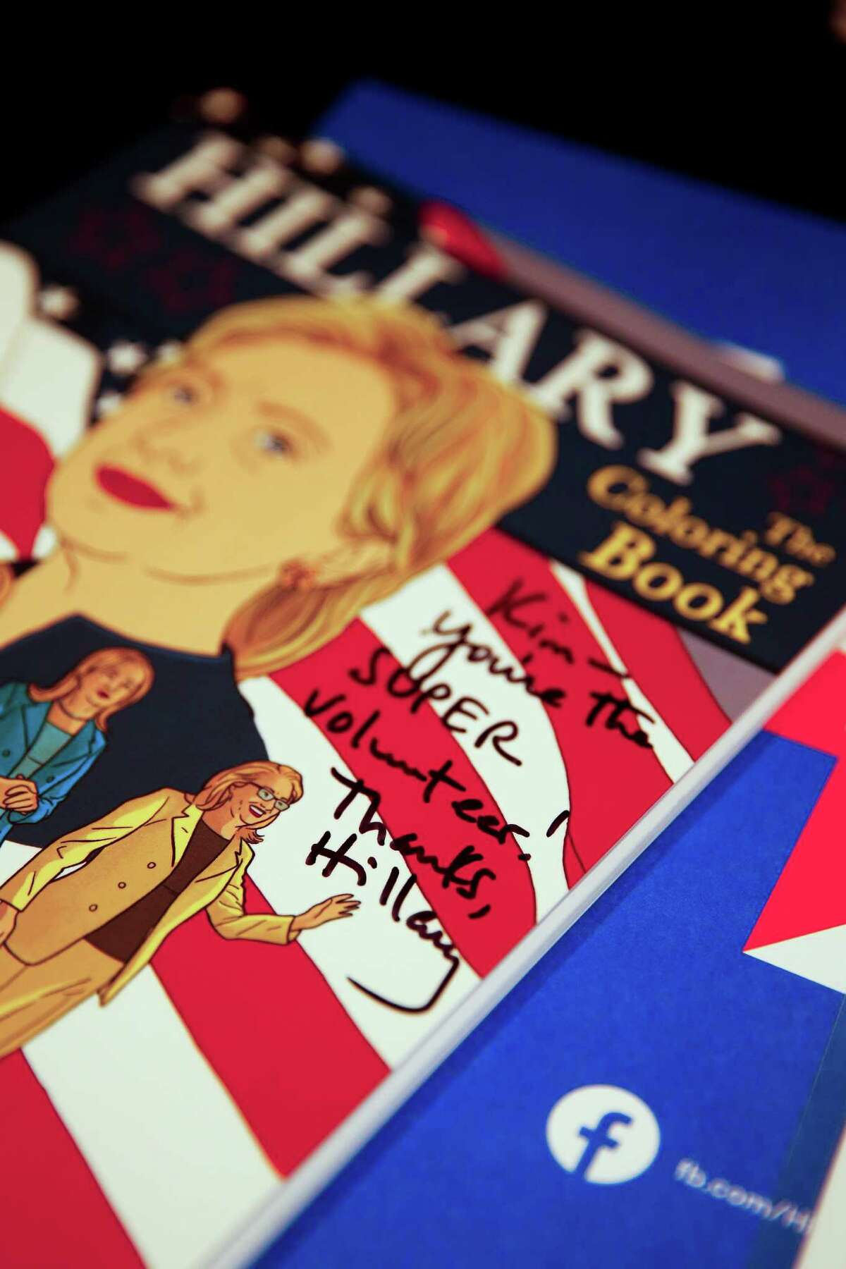 A signed copy of Hillary The Coloring Book addressed to Hillary Clinton supporter and founder of HRC Super Volunteers Kim Frederick sits in Frederick's home Wednesday, Nov. 2, 2016 in Houston.