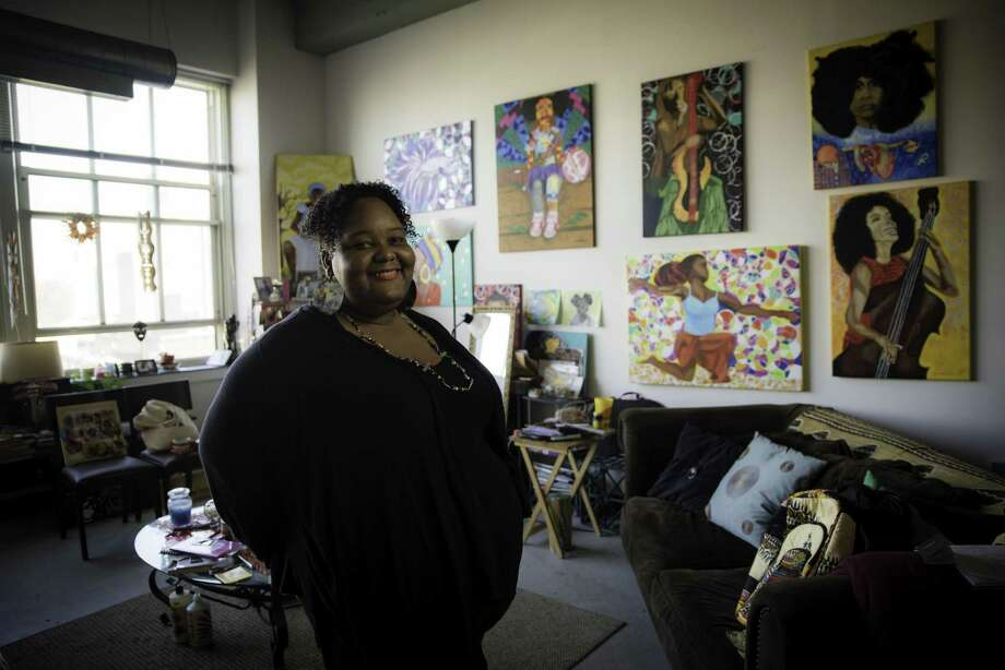 Shanna Melton, surrounded by her art, is a poet and painter living in the Read Building in Bridgeport. Photo: Kyle Michael King / For Hearst Connecticut Media / Hearst Connecticut Media Group Freelance