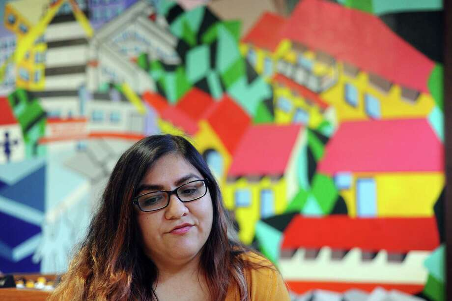 27-year-old Wendy Cardenas, originally from Peru, discusses her fears of the potential immigration policies of President-elect Donald Trump at Neighbor's Link in Stamford, Conn. on Thursday, Nov. 10, 2016. Photo: Michael Cummo / Hearst Connecticut Media / Stamford Advocate
