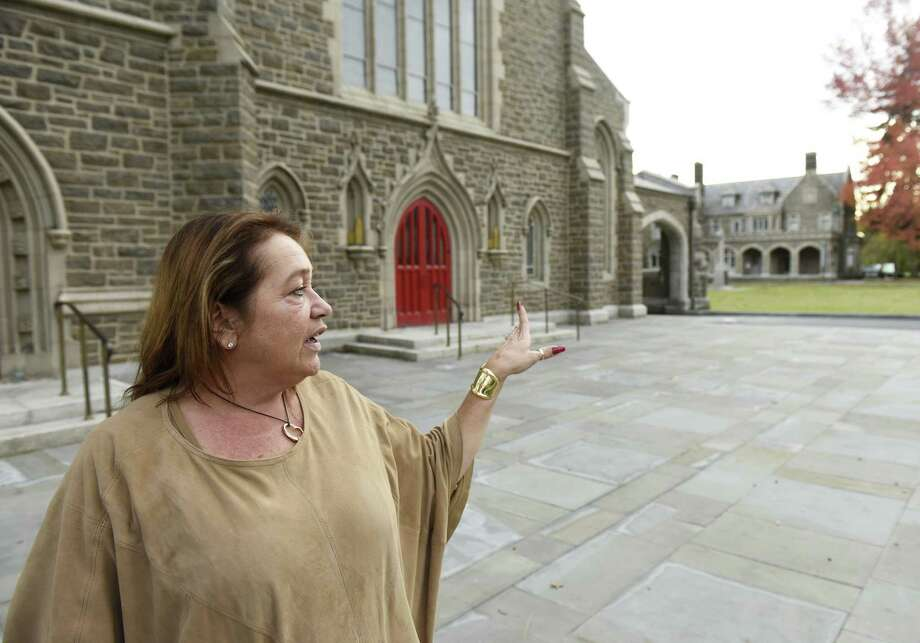 Susan Reed, Executive Director of Marketing and Parish Relations, show the newly-revamped exterior of Christ Church in Greenwich on Thursday. The renovation is part of a $10 million project and includes a new courtyard, benches, sidewalks and general clean-up in the front of the church along Post Road. Photo: Tyler Sizemore / Hearst Connecticut Media / Greenwich Time