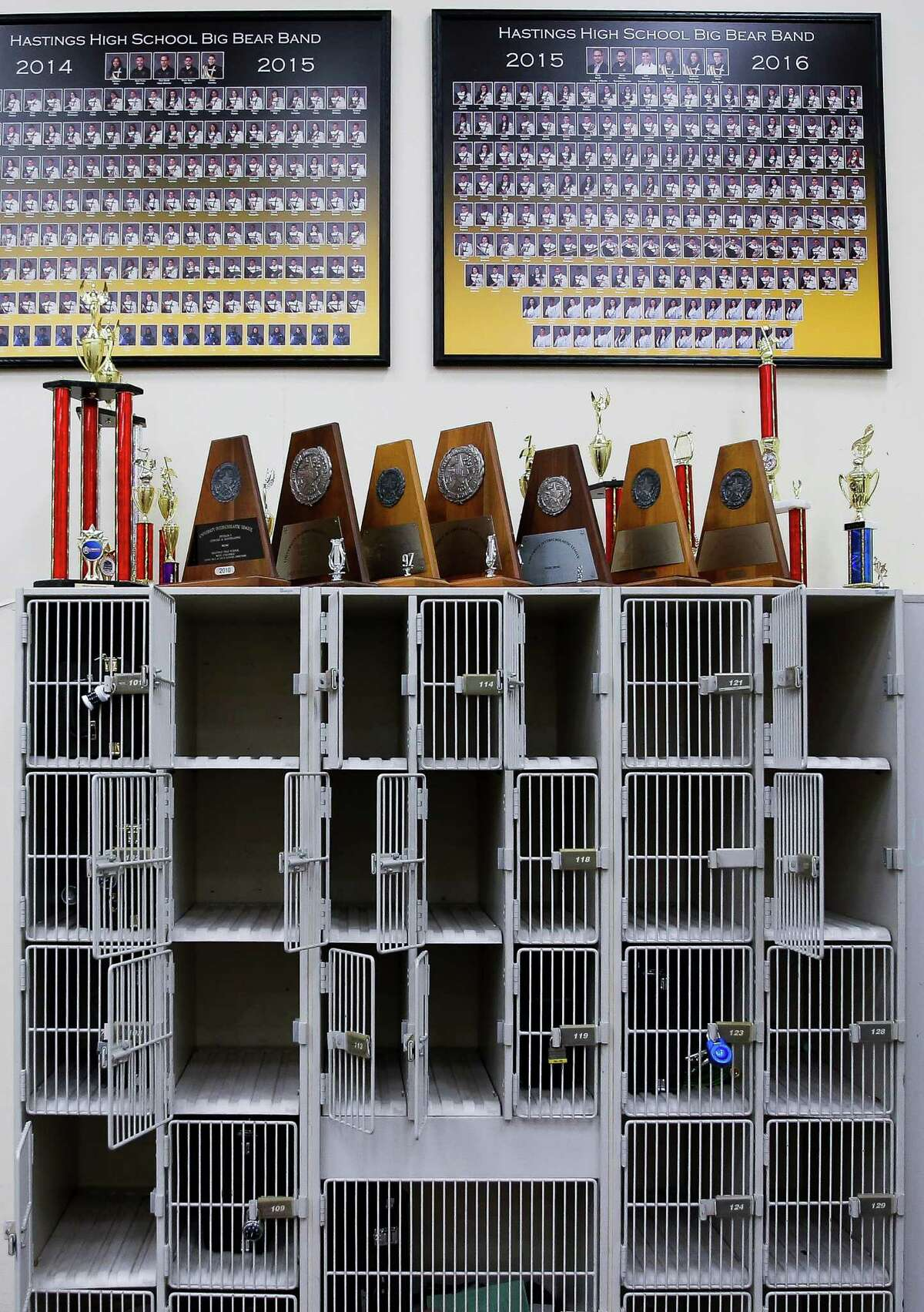 Instrument storage lockers at Hastings High School sit empty after someone walked into the band room and stole school-issued instruments.