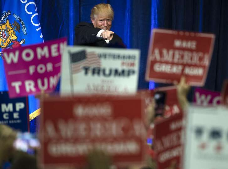 FILE - In this Tuesday, Nov. 1, 2016, Republican presidential candidate Donald Trump gestures during a campaign state at the University of Wisconsin-Eau Claire in Eau Claire, Wis. In his victory speech, Trump called them America�s �forgotten men and women�,  the workers from the coalfields of Appalachia to the hallowing manufacturing towns of the Rust Belt who propelled him to an improbable victory. They felt left behind by progress, laughed at by the elite, and so put their faith in the billionaire businessman with a sharp tongue and short temper. (AP Photo/Matt Rourke, File)