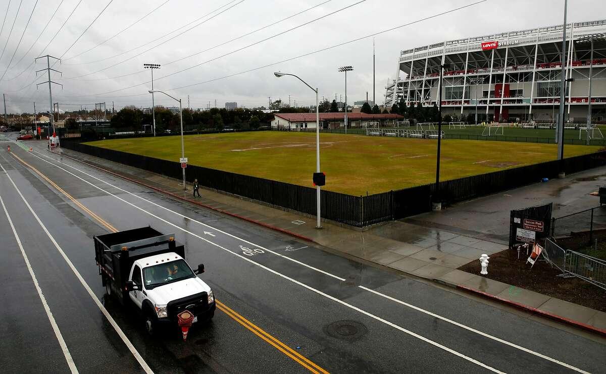 A construction truck drives past the Santa Clara Youth Soccer Park near Levi's Stadium in Santa Clara, California, on Tuesday, Jan. 5, 2016.