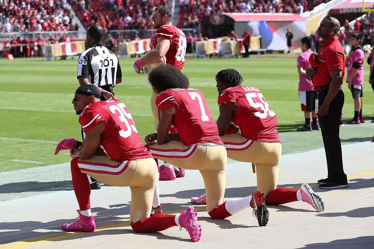 San Francisco 49ers Eric Reid (35), Colin Kaepernick (7) and Eli Harold (58) kneel during the National Anthem prior to an NFL football game against the Tampa Bay Buccaneers on Oct. 23, 2016 in Santa Clara, CA. The Bucs defeated the Niners 34-17. (Daniel Gluskoter/AP Images for Panini)
