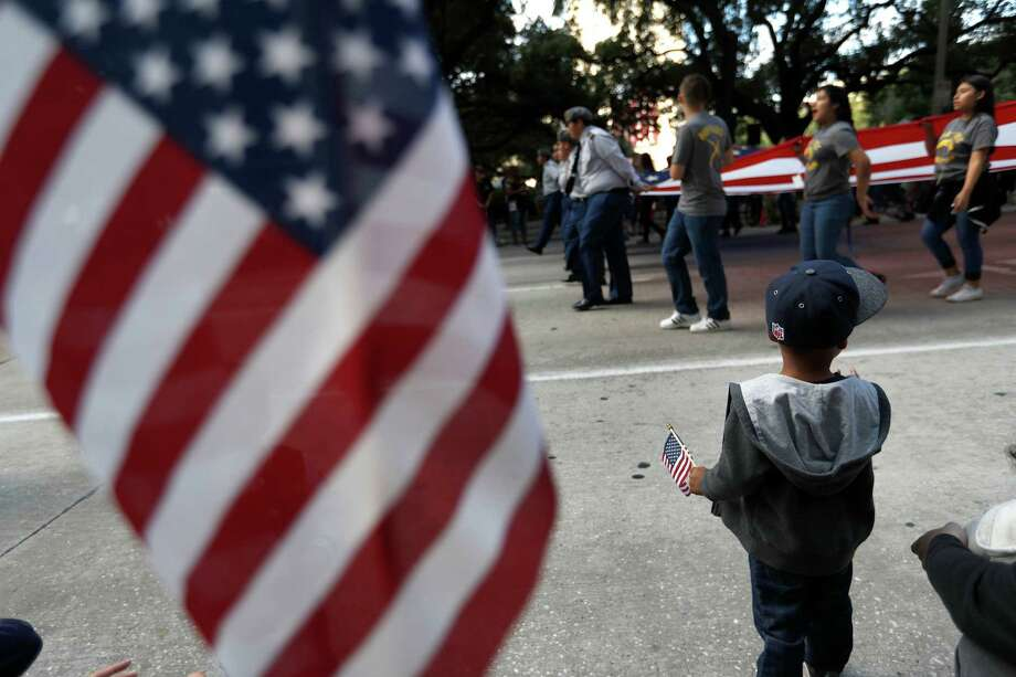 "Marion Lara, 3, watches during the ""Houston Salutes American Heros"" Veterans Day parade at City Hall on Friday. In addition to the parade, the city's official celebration included a job, resource and health fair. Photo: Karen Warren, Staff Photographer / 2016 Houston Chronicle"
