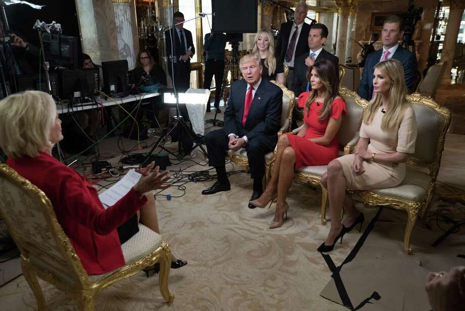 """Lesley Stahl, left, interviews President-elect Donald J. Trump and his family, wife Melania, daughter Ivanka, seated right, daughter Tiffany, seated second row from left, and sons Donald Jr. and Eric at his home Friday in New York. Trump's first post-election interview will be broadcast on """"60 Minutes"""" on Sunday. Photo: Chris Albert, HONS / CBSNews/60MINUTES"""