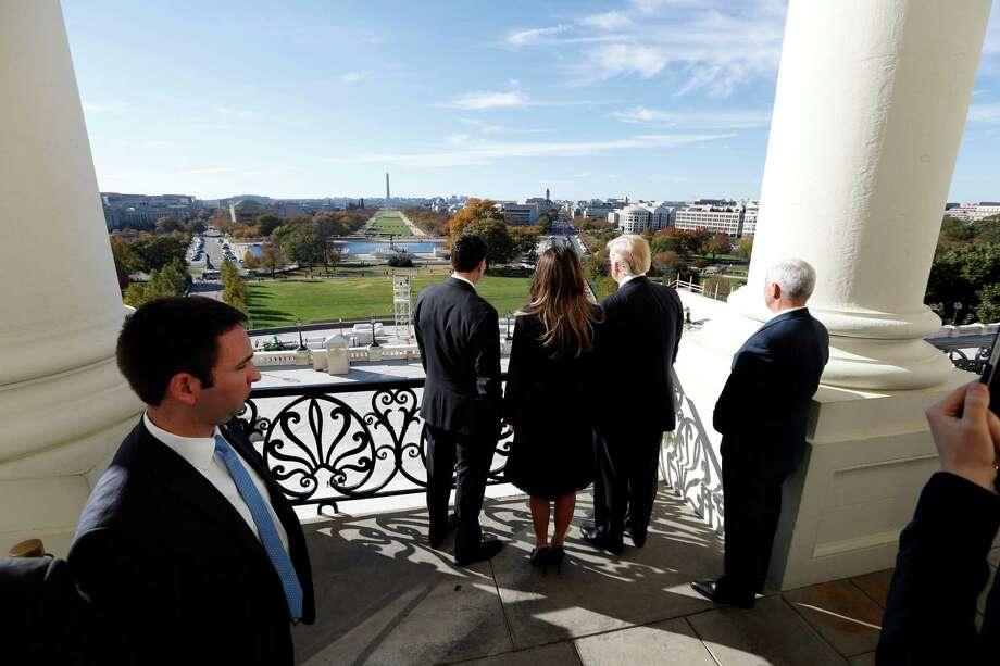 House Speaker Paul Ryan, left, shows President-elect Donald Trump, his wife, Melania, and Vice president-elect Mike Pence the view of the inaugural stand that is being built, from his office on Capitol Hill. (Alex Brandon / Associated Press) Photo: Alex Brandon, STF / AP