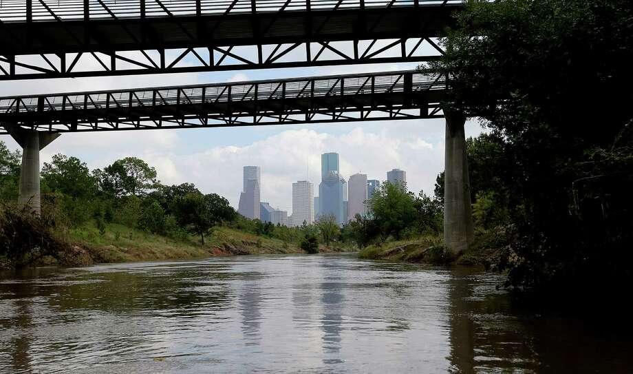 The Houston skyline is visible anytime canoeists paddle down Buffalo Bayou at Buffalo Bayou Park. ( Elizabeth Conley / Houston Chronicle ) Photo: Elizabeth Conley, Staff / © 2015 Houston Chronicle