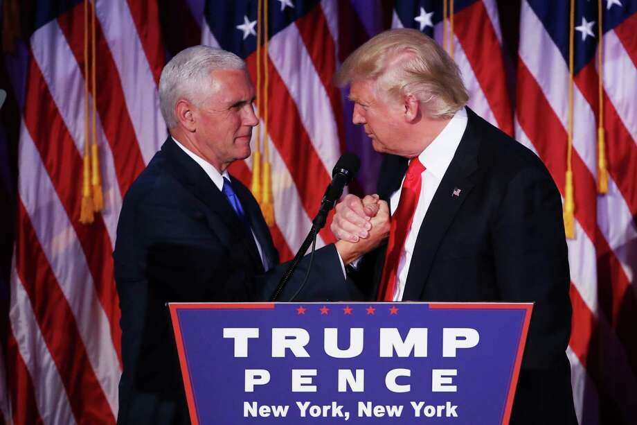 Vice president-elect Mike Pence and Republican president-elect Donald Trump shake hands during his election night event at the New York Hilton Midtown in the early morning hours of Nov. 9, 2016 in New York City. Donald Trump defeated Democratic presidential nominee Hillary Clinton to become the 45th president of the United States.  (Photo by Mark Wilson/Getty Images) Photo: Mark Wilson, Staff / 2016 Getty Images
