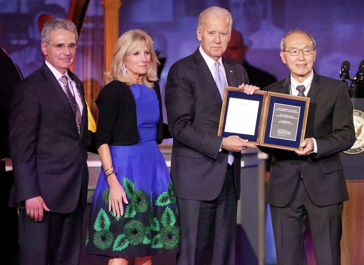 United States Vice President Joe Biden and his wife, Dr. Jill Biden, receive a special plaque commemorating the new Beau Biden Chair for Brain Cancer Research from Dr. Alfred Yung and University of Texas MD Anderson Cancer Center President Dr. Ronald DePinho at the institution's 75th Anniversary Gala on Thursday, November 10, in Houston. Biden's son, Beau Biden, was admitted and treated at MD Anderson for brain cancer in 2013.