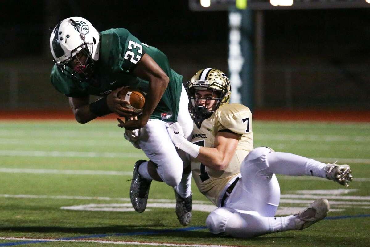 Norwalk's Marlon Brown Jr. is tackled by Adam Tolk during the Bear's game against Trumbull at Norwalk High School in Norwalk, Conn. on Friday, Nov. 11, 2016.
