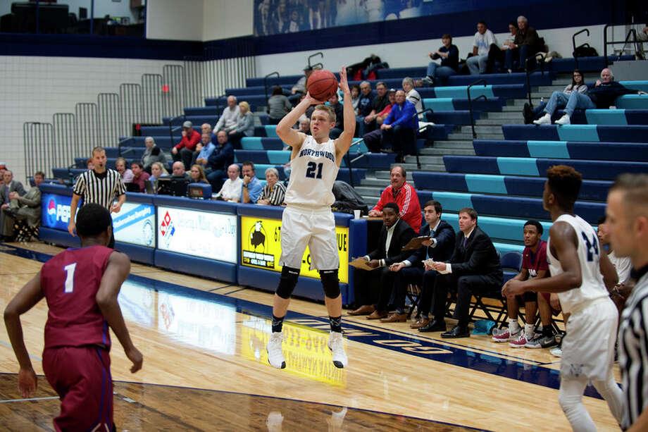 BRITTNEY LOHMILLER | blohmiller@mdn.net Northwood University's Zach Allread shoots for three points in the first half of Northwood's season opener against Saint Joseph's Friday evening.