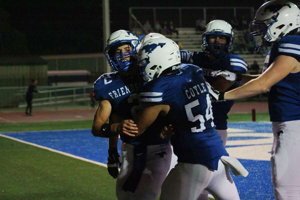 Friendswood's Tyler Page (2) is congratulated by Friendswood's Nathan Coyle (54) after scoring a touchdown against George Ranch in the first half Friday, Nov. 11 at Friendswood High School.