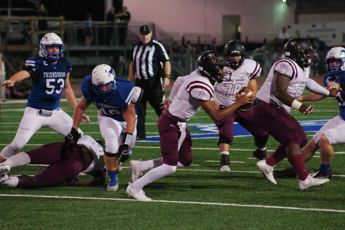 George Ranch's Antonio Jackson (2) scrambles for yardage against Friendswood in the first half Friday, Nov. 11 at Friendswood High School.