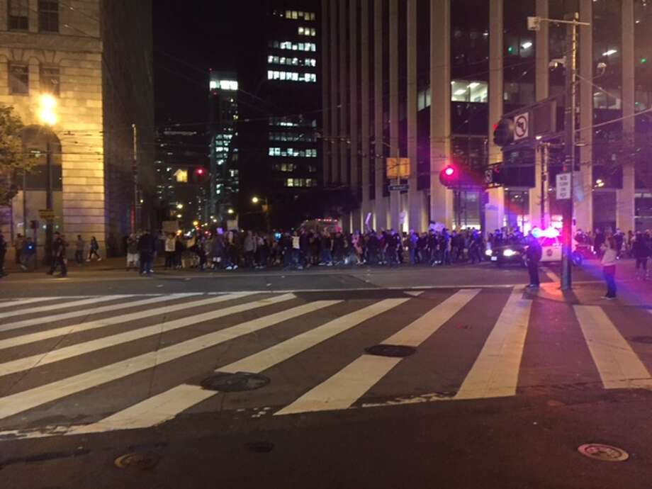 Anti-Trump protesters block Market Street at Pine Street in San Francisco on Nov. 11, 2016. It's the third straight night of protests since Donald Trump was elected president. Photo: Alix Martichoux
