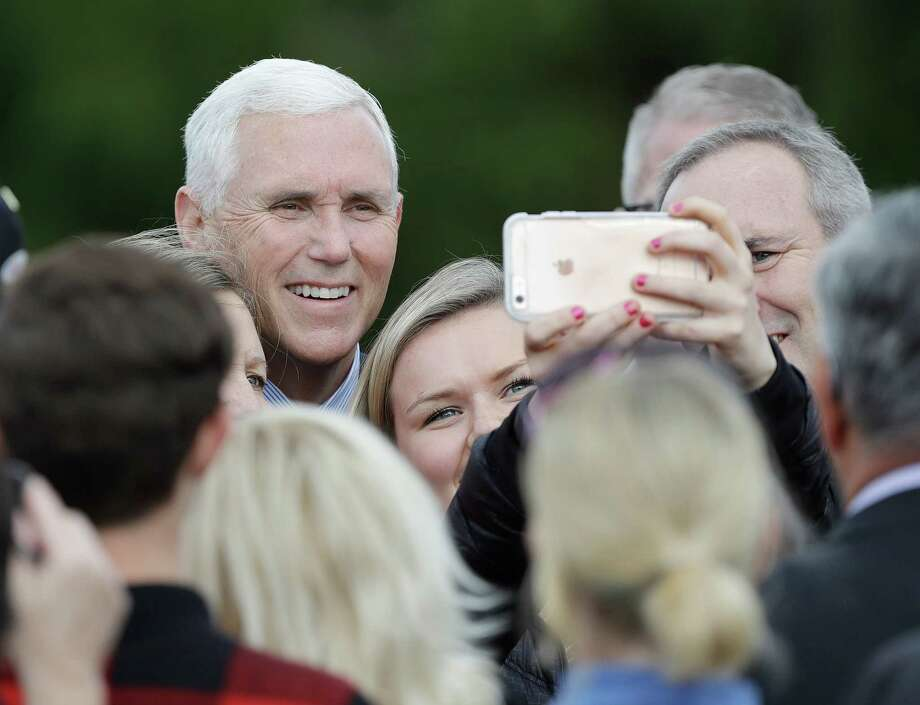 Vice President-elect Mike Pence poses for photos after speaking at a Veterans Day ceremony at Camp Atterbury in Edinburgh, Ind., Friday, Nov. 11, 2016. (AP Photo/Darron Cummings) ORG XMIT: INDC111 Photo: Darron Cummings / Copyright 2016 The Associated Press. All rights reserved.