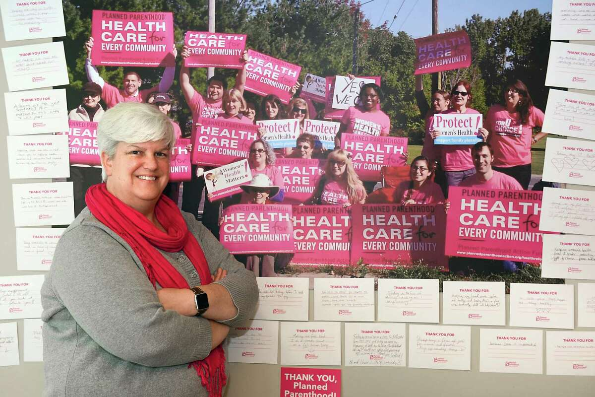 """Upper Hudson Planned Parenthood CEO Chelly Hegan stands next to """"thank-you"""" cards from an event last night on Friday, Nov. 11, 2016 in Albany, N.Y. (Lori Van Buren / Times Union)"""