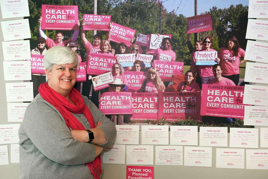 "Upper Hudson Planned Parenthood CEO Chelly Hegan stands next to ""thank-you"" cards from an event last night on Friday, Nov. 11, 2016 in Albany, N.Y. (Lori Van Buren / Times Union) Photo: Lori Van Buren / 20038783A"
