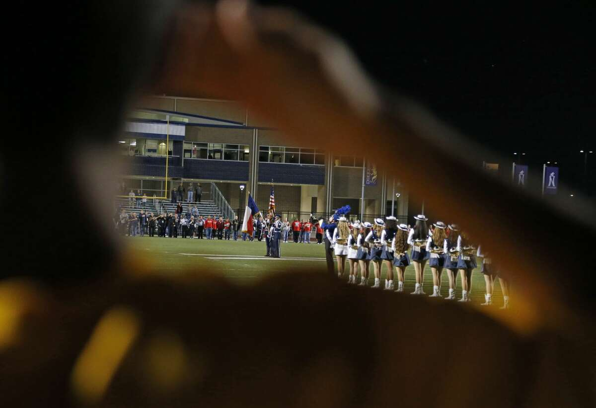 FILE PHOTO - An O'Connor cadet salutes during the flag during the National Anthem ahead of the high school football playoff game between O'Connor and Judson on November 11,2016 at Farris Stadium.
