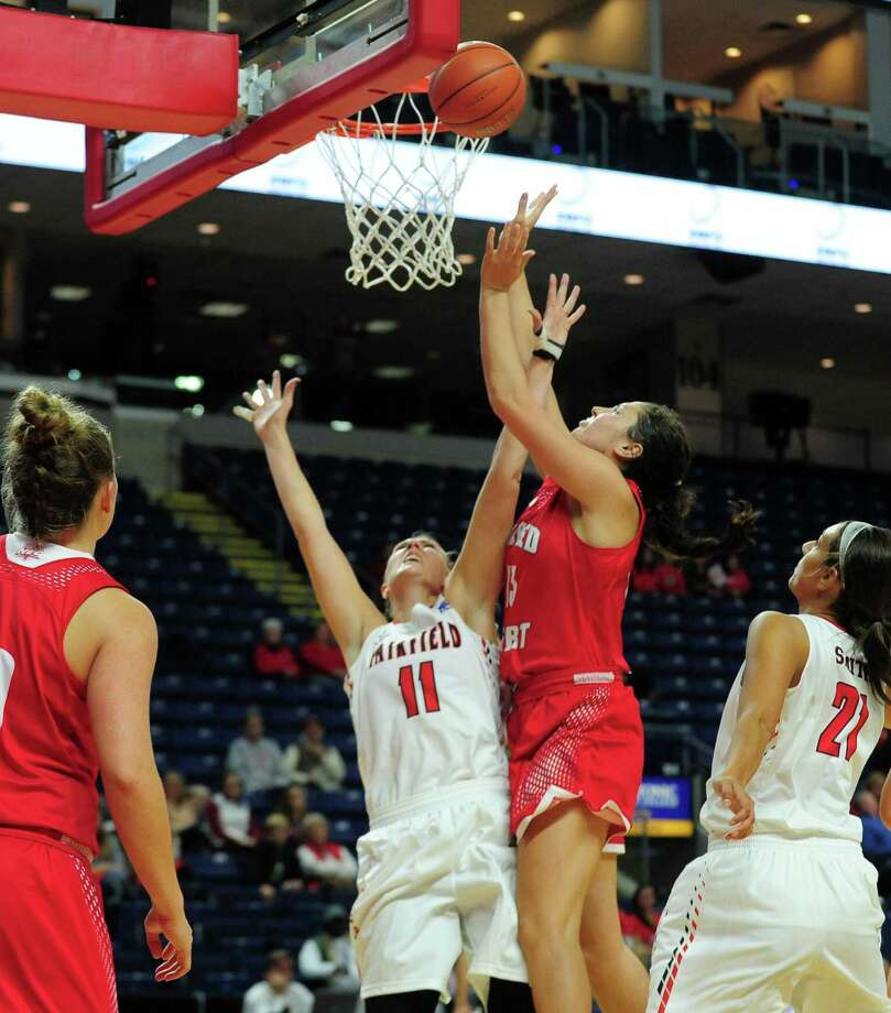 Sacred Heart's Katherine Haines shoots over Fairfield's Samantha Cooper in Friday's game in Bridgeport. Photo: Christian Abraham / Hearst Connecticut Media / Connecticut Post