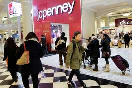 "Shoppers visit a J.C. Penney store in New York. ""We are hoping that in the post-election,  we are just going to see people spend,""  Penney's CEO Marvin Ellison says."