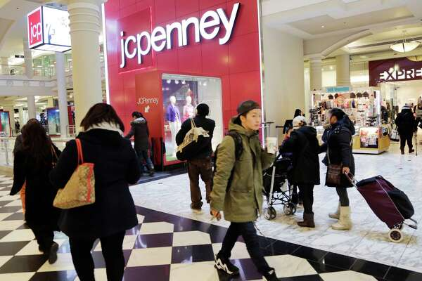 """Shoppers visit a J.C. Penney store in New York. """"We are hoping that in the post-election,  we are just going to see people spend,""""  Penney's CEO Marvin Ellison says."""