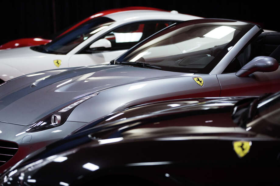 Ferraris are displayed in the Seattle International Auto Show at the CenturyLink Field Event Center, Friday, Nov. 11, 2016. Photo: GRANT HINDSLEY, SEATTLEPI.COM / SEATTLEPI.COM
