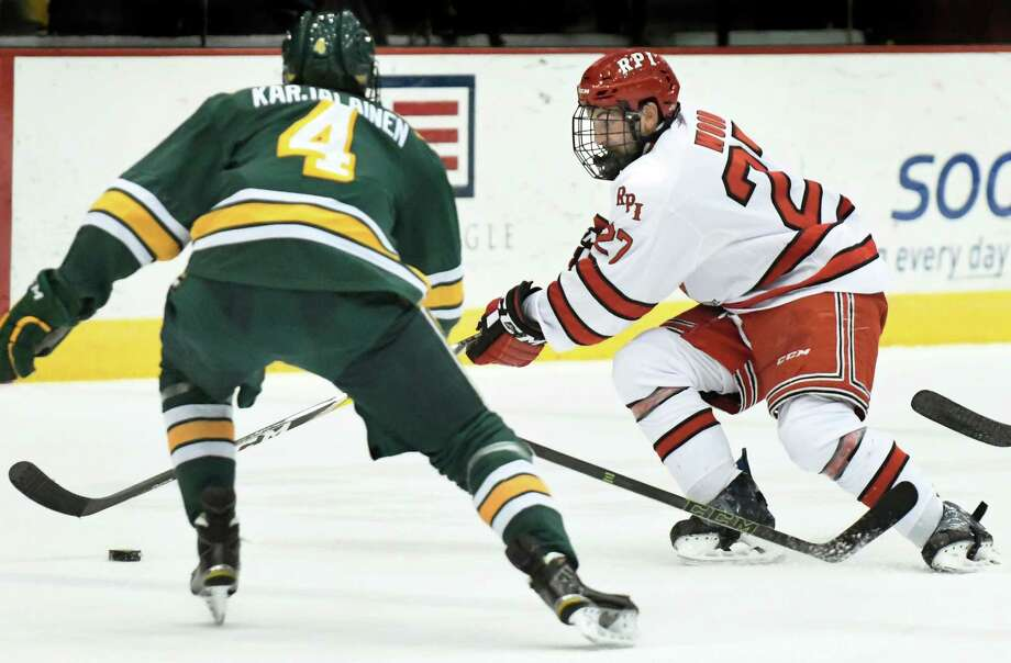 RPI's Jake Wood, right, pursues the puck as Clarkson's Tyko Karjalainen defends during their hockey game on Friday, Nov 11, 2016, at Houston Field House in Troy, N.Y. (Cindy Schultz / Times Union) Photo: Cindy Schultz / Albany Times Union