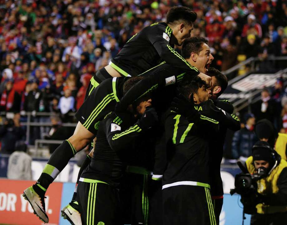 Members of Mexico's team celebrate Rafael Marquez's goal in the 89th minute that proved the difference in the World Cup qualifying match. Photo: PAUL VERNON, Stringer / AFP or licensors