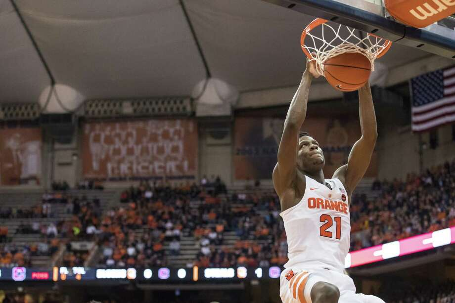 SYRACUSE, NY - NOVEMBER 11:  Tyler Roberson #21 of the Syracuse Orange puts in a slam dunk during the first half against the Colgate Raiders at The Carrier Dome on November 11, 2016 in Syracuse, New York.  (Photo by Brett Carlsen/Getty Images) ORG XMIT: 673169835 Photo: Brett Carlsen / 2016 Getty Images