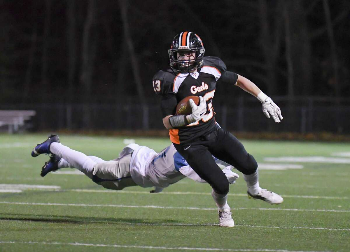 Ronnie Rich (23) of the Shelton Gaels avoids a tackle during a game against the West Haven Blue Devils on November 11, 2016 at Shelton High School in Shelton, Connecticut.
