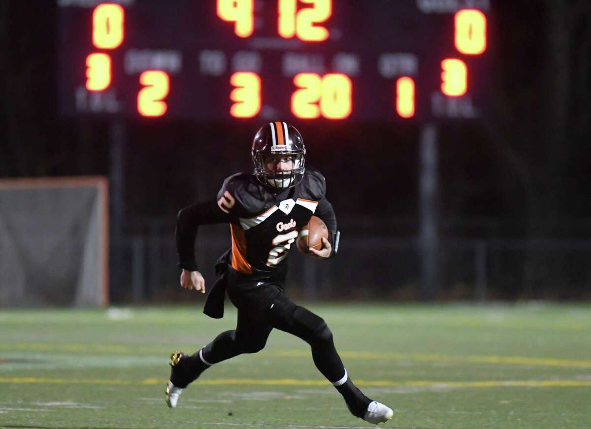 David Wells (2) of the Shelton Gaels rushes for a touchdown during a game against the West Haven Blue Devils on November 11, 2016 at Shelton High School in Shelton, Connecticut.