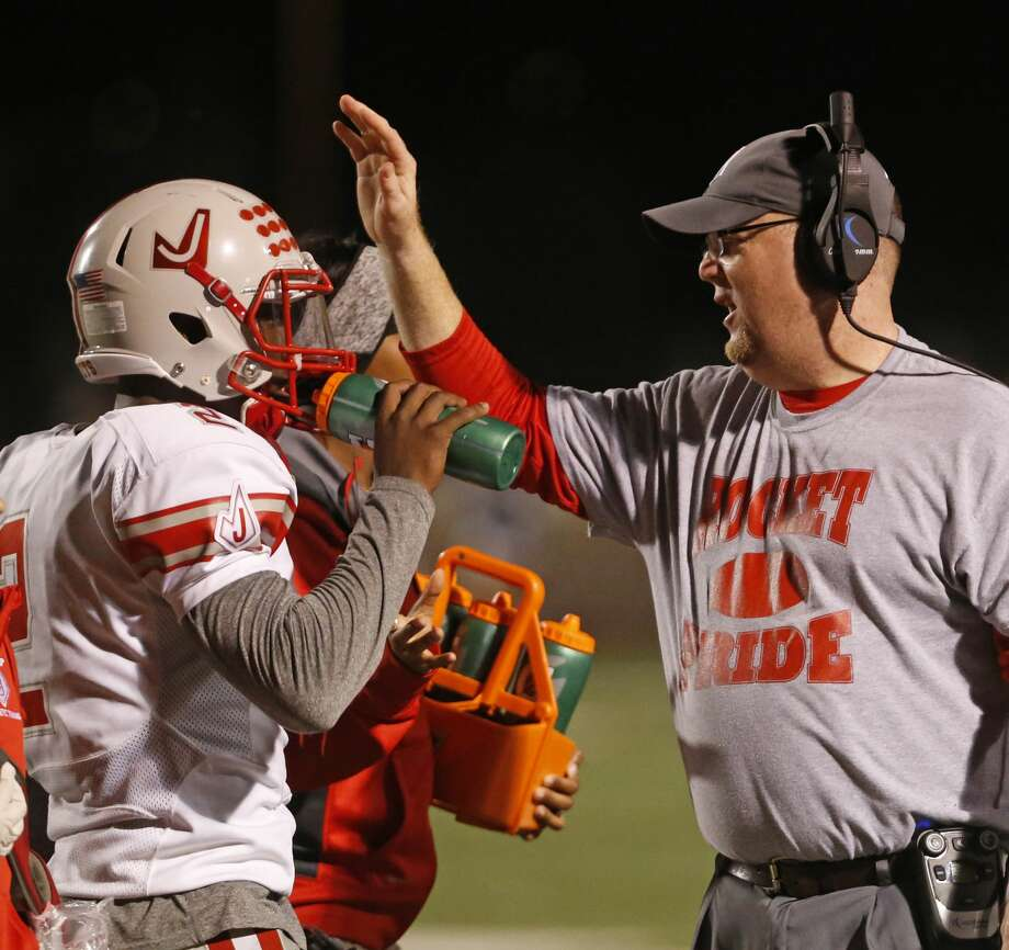 Judson head coach Sean McAuliffe congratulates his players after a TD from the Class 6A Division I bidistrict high school football playoff game between O'Connor and Judson on November 11,2016 at Farris Stadium. Photo: Ron Cortes/Ronald Cortes