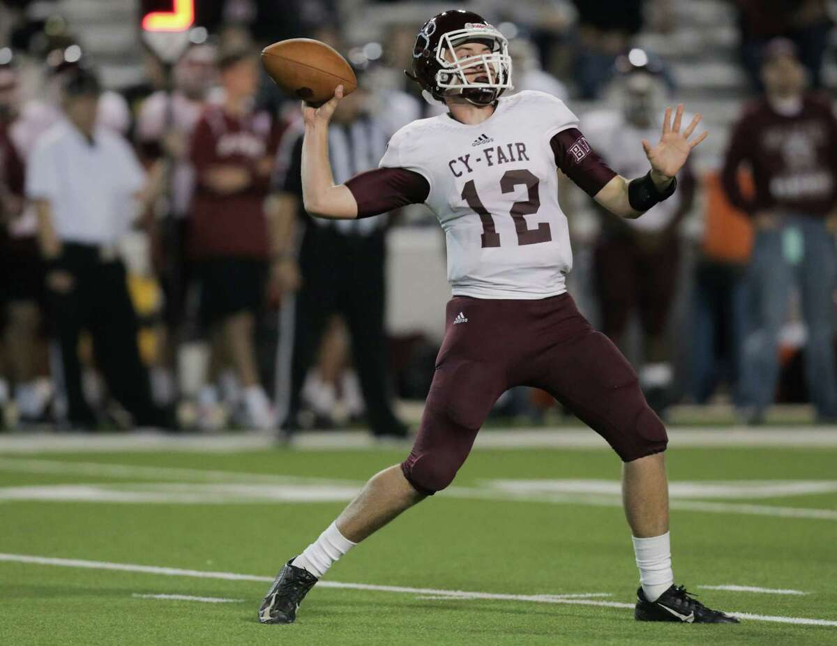 Cy-Fair quarterback Cameron Arnold (12) throws the ball in the second half during Class 6A, Division 1 bi-district high school playoffs against Lamar on Friday, Nov. 11, 2016, in Houston. Lamar won the game 15-14.