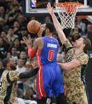 Detroit Pistons center Andre Drummond (0) passes the ball as he is defended by San Antonio Spurs' Pau Gasol, right, of Spain, and LaMarcus Aldridge during the second half of an NBA basketball game, Friday, Nov. 11, 2016, in San Antonio. San Antonio won 96-86. (AP Photo/Darren Abate)