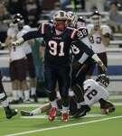 Lamar's Devon Tibbs celebrates after sacking Cy-Fair quarterback Cameron Arnold on Friday night at Delmar Stadium.