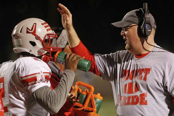 Judson head coach Sean McAuliffe congratulates his players after a TD from the Class 6A Division I bidistrict high school football playoff game between O'Connor and Judson on November 11,2016 at Farris Stadium.