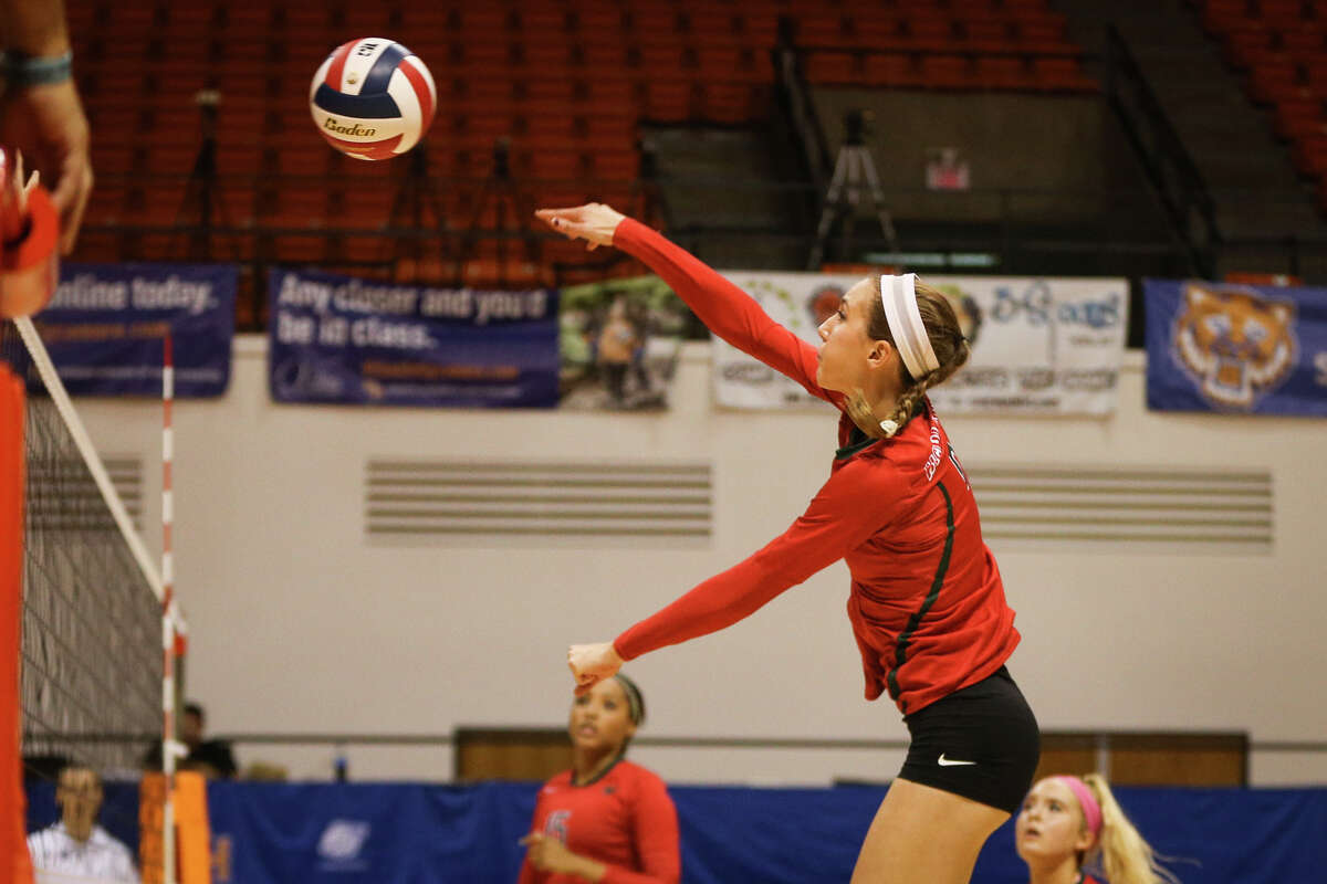 The Woodlands' Courtney Heiser (6) hits the ball during the varsity volleyball game against Westwood on Friday, Nov. 11, 2016, at Johnson Coliseum in Huntsville, Texas. (Michael Minasi / Chronicle)