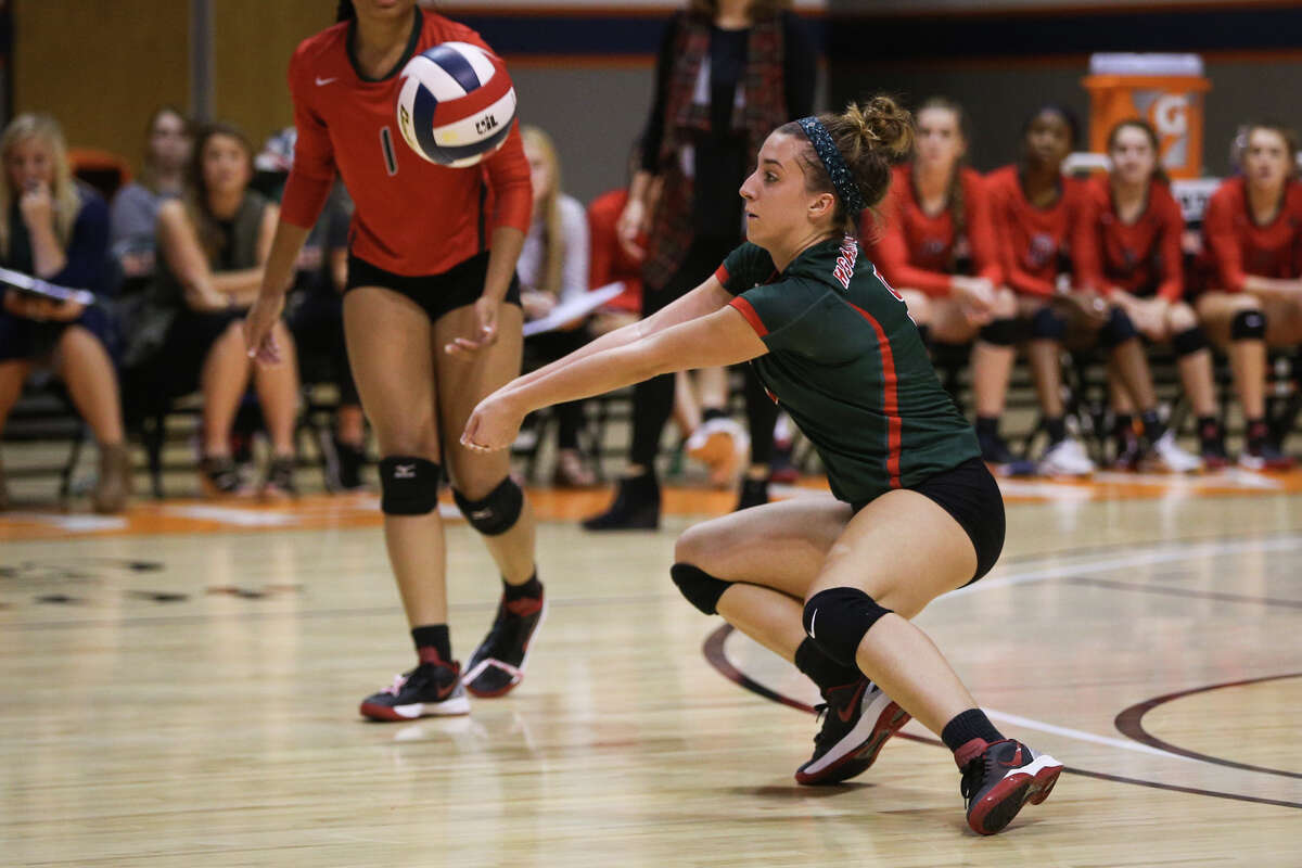 The Woodlands' Mia Primavera (5) digs the ball during the varsity volleyball game against Westwood on Friday, Nov. 11, 2016, at Johnson Coliseum in Huntsville, Texas. (Michael Minasi / Chronicle)