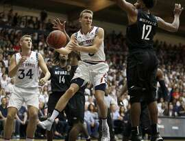 Saint Mary's Emmett Naar, center, passes away from Nevada's Elijah Foster (12) during the first half of an NCAA college basketball game Friday, Nov. 11, 2016, in Moraga, Calif. (AP Photo/Ben Margot)