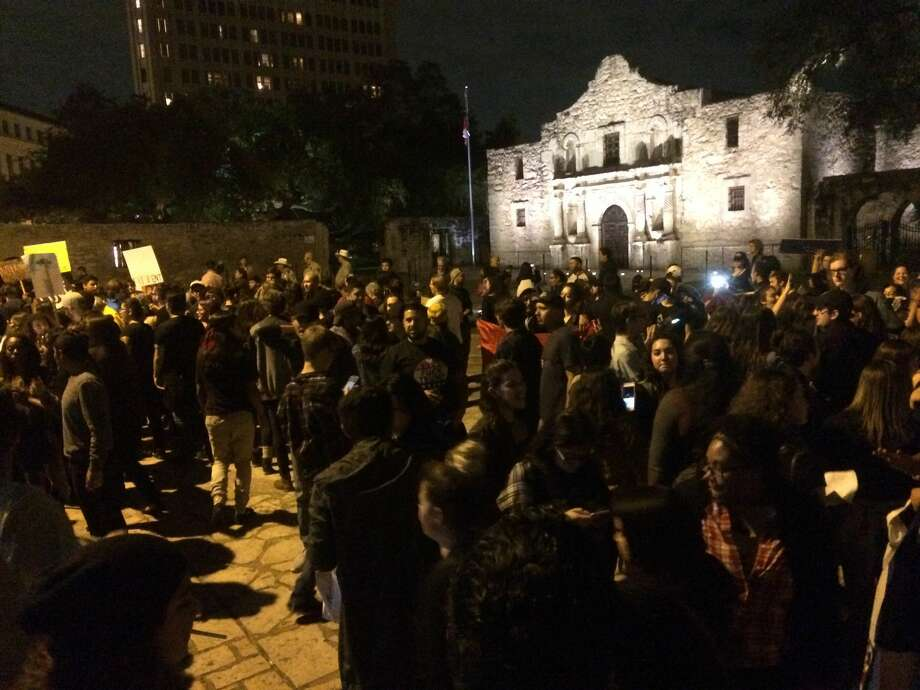 A few hundred protesters gathered at Alamo Plaza Friday night to show anger that Donald Trump was elected President of the United States. The protest lasted about an hour and branched off down the River Walk and surrounding streets. Photo: By Lauren Carub