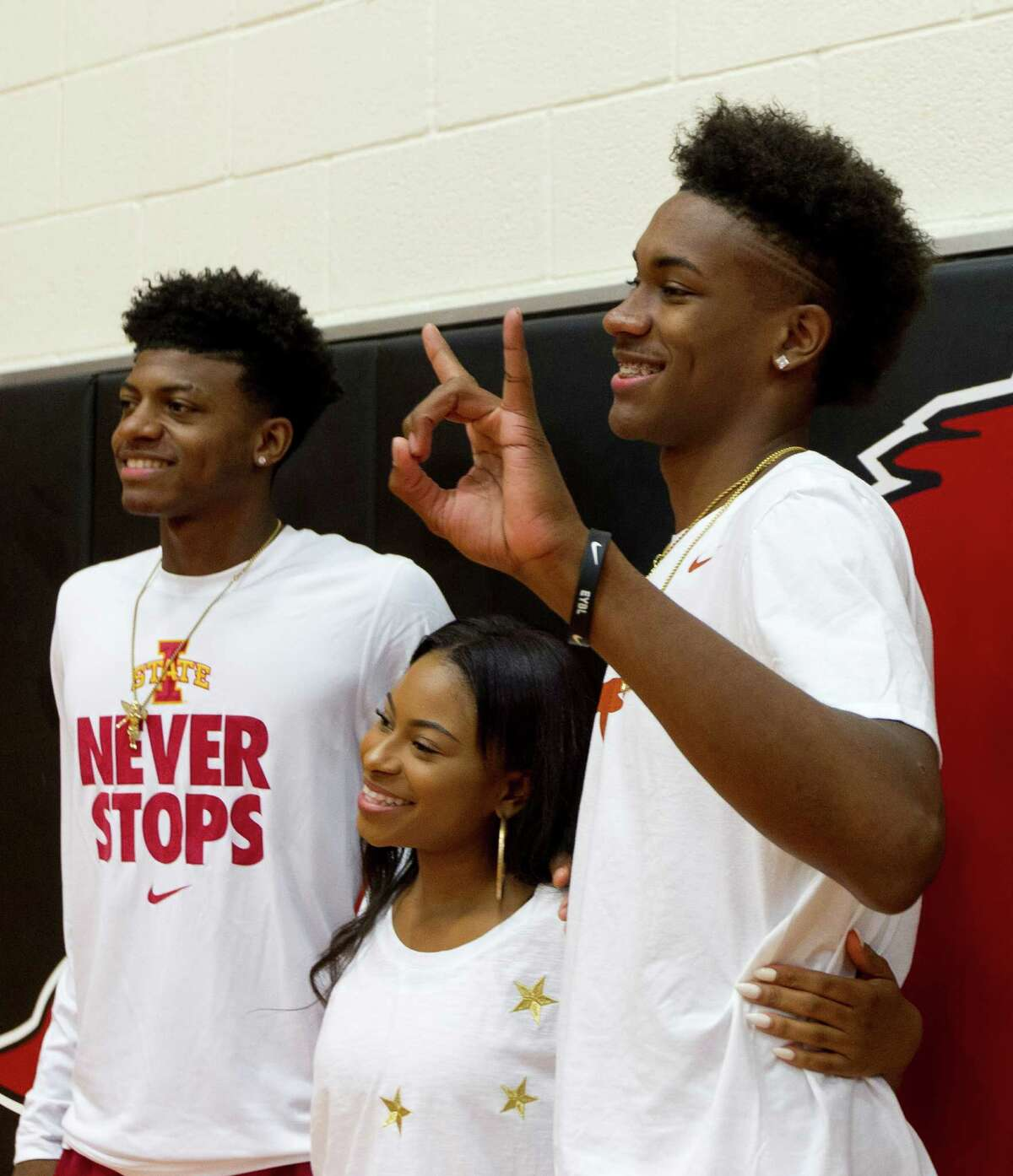Westfield basketball players Darius McNeil, left, and Jase Febres pose with friends during a national signing day ceremony at Westfield High School Wednesday, Nov. 9, 2016, in Spring. McNeil signed to play basketball at Iowa State University, while Febres will play for the University of Texas.