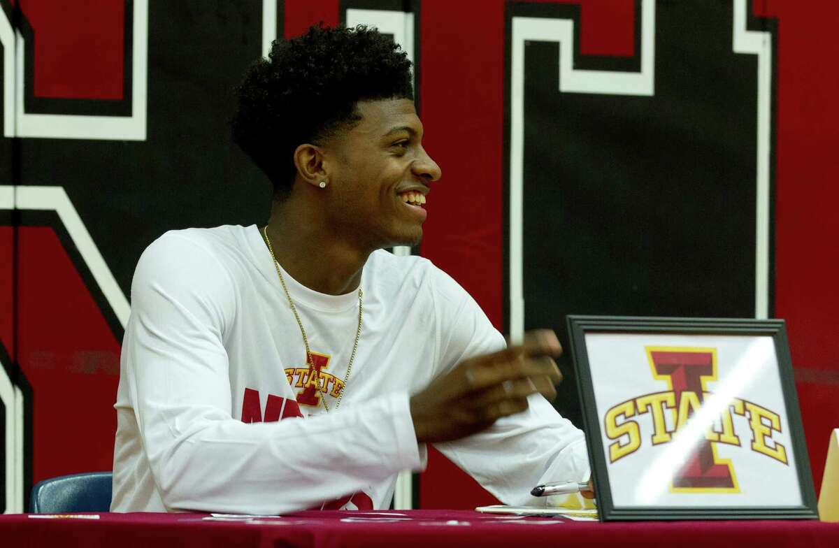 Westfield basketball player Darius McNeil laughs during a national signing day ceremony at Westfield High School Wednesday, Nov. 9, 2016, in Spring. McNeil signed to play basketball at Iowa State University, while teammate Jase Febres will play for the University of Texas.