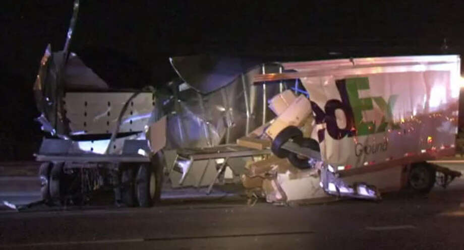 Packages went flying when the tail of a FedEx tandem trucker trailer met the front-end of a train in a midnight wreck in Missouri City.  The collision happened around 12:15 a.m. Saturday on a railroad track on South Main at Cravens. Photo: Metro Video