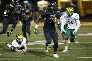 Antioch's Najee Harris, 2 on a second half run, as the Antioch Panthers take on the San Ramon Valley Wolves in a North Coast Section playoff game in Antioch, California, on Friday November 11, 2016