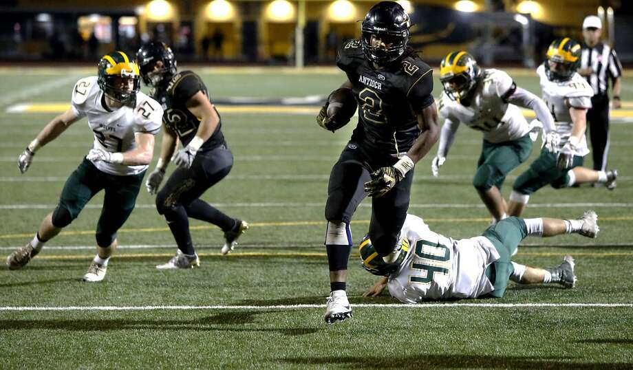 Antioch's Najee Harris, 2 walks into the end zone on a second half touchdown run, as the Antioch Panthers take on the San Ramon Valley Wolves in a North Coast Section playoff game in Antioch on Friday November 11. His team will face California-San Ramon in a semi-final game on Saturday evening.  Photo: Michael Macor, The Chronicle