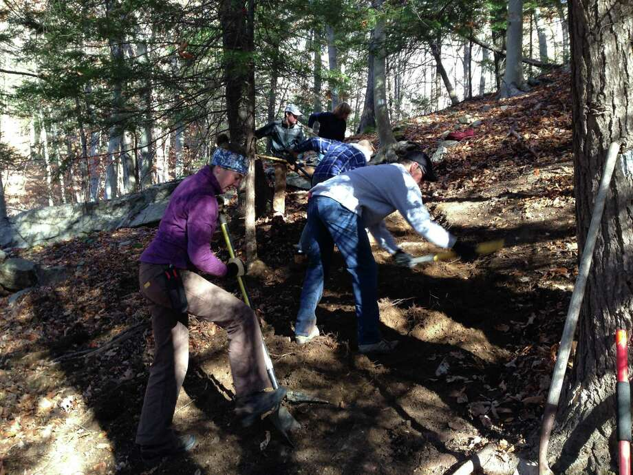 Volunteers clear a trail in Ridgefield Saturday. Photo: Contributed Photo