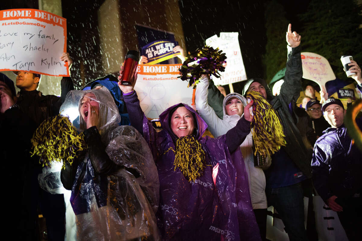 University of Washington fans cheer for a live broadcast for SportsCenter before ESPN's College GameDay at UW's Red Square, Saturday, Nov. 12, 2016. GameDay begins at 6 a.m. this Saturday in Pullman.