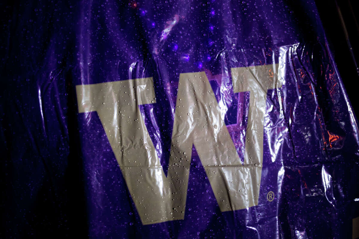 Rain drops dot a fans poncho at ESPN's College GameDay at University of Washington's Red Square, Saturday, Nov. 12, 2016. GameDay has moved to Pullman this year for the WSU-Oregon game..